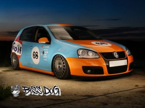 VW golf mk5 wrapped in gloss orange and blue gulf sceme for sixbe