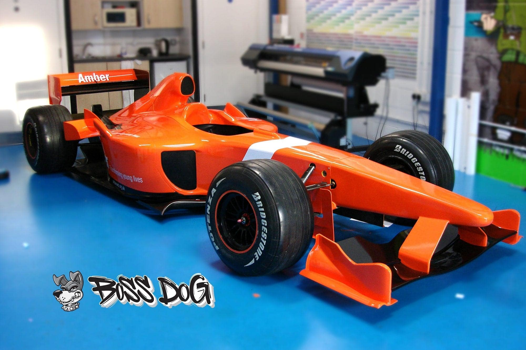 formular 1 car wrapped in gloss orange